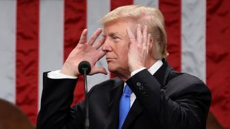 U.S. President Donald Trump gestures while delivering a State of the Union address to a joint session of Congress at the U.S. Capitol in Washington, D.C., U.S., on Tuesday, Jan. 30, 2018. Trump sought to connect his presidency to the nation's prosperity in his first State of the Union address, arguing that the U.S. has arrived at a 'new American moment' of wealth and opportunity. Photographer: Win McNamee/Pool via Bloomberg