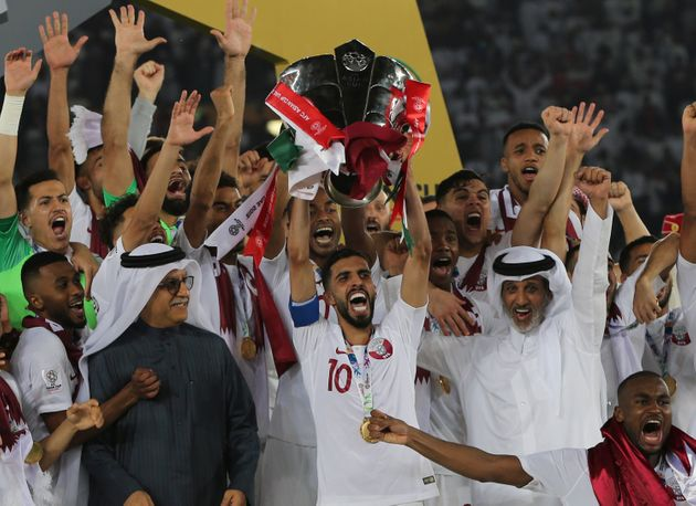 Qatar players lift the trophy after winning the AFC Asian Cup final match between Japan and Qatar in...