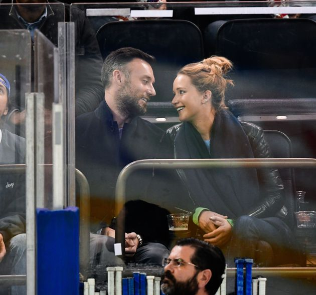 Jennifer Lawrence and Cooke Maroney at a hockey game in