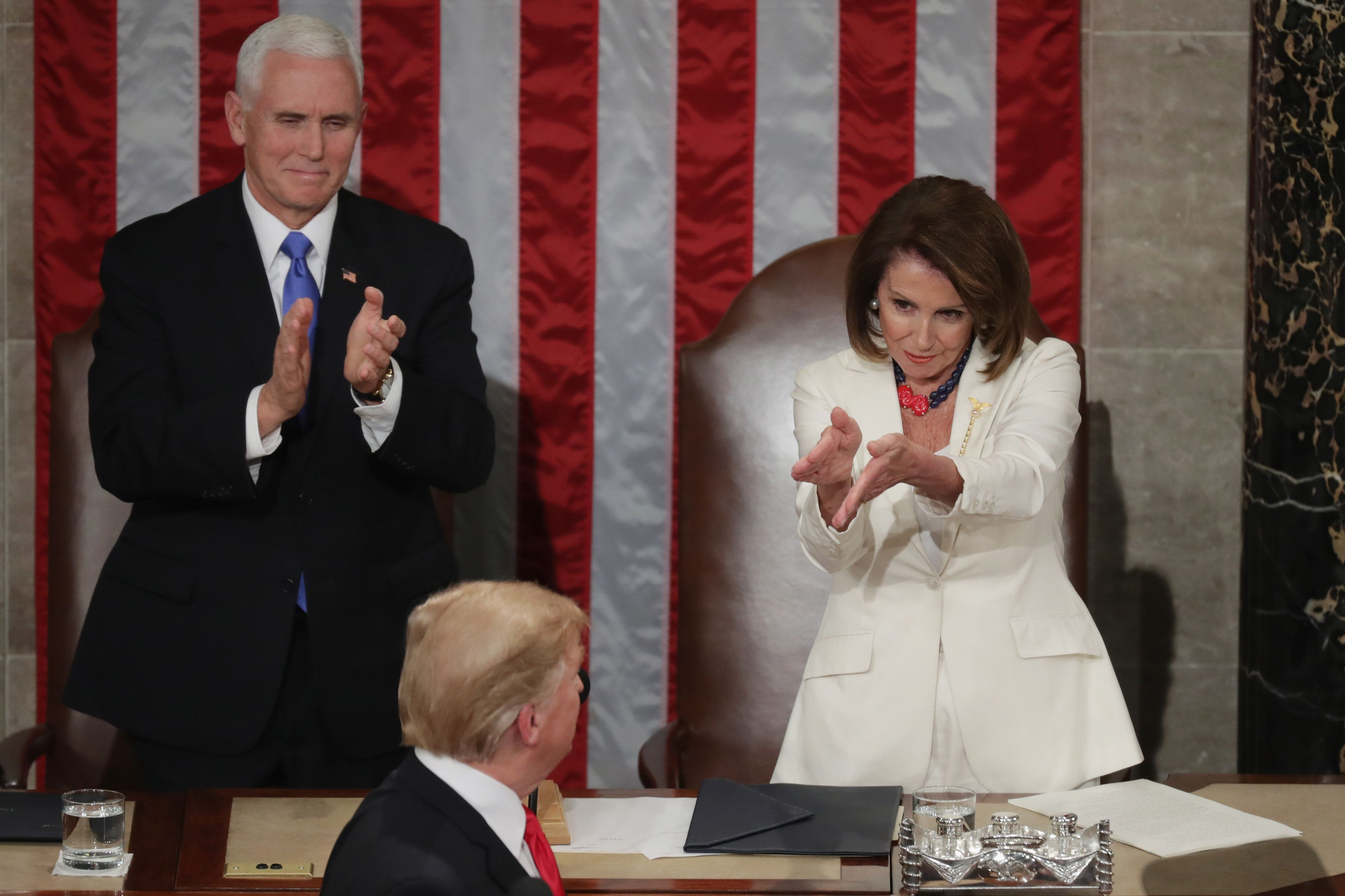 WASHINGTON, DC - FEBRUARY 05: Vice President Mike Pence and Speaker Nancy Pelosi greet President Donald Trump just ahead of the State of the Union address in the chamber of the U.S. House of Representatives at the U.S. Capitol Building on February 5, 2019 in Washington, DC. President Trump's second State of the Union address was postponed one week due to the partial government shutdown.  (Photo by Chip Somodevilla/Getty Images)