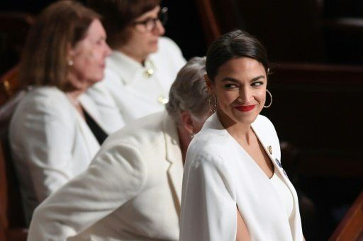 Democrat Alexandria Ocasio-Cortez was one of the many congresswomen who came dressed in white for the president's annual speech to Congress