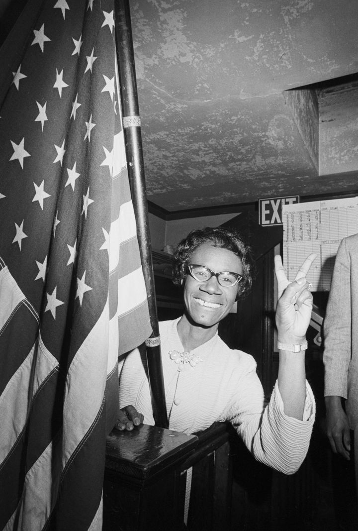 Shirley Chisholm gives the victory sign after winning the congressional election in Brooklyn's 12th District in 1968. She defeated civil rights leader James Farmer to become the first African American woman elected to Congress.