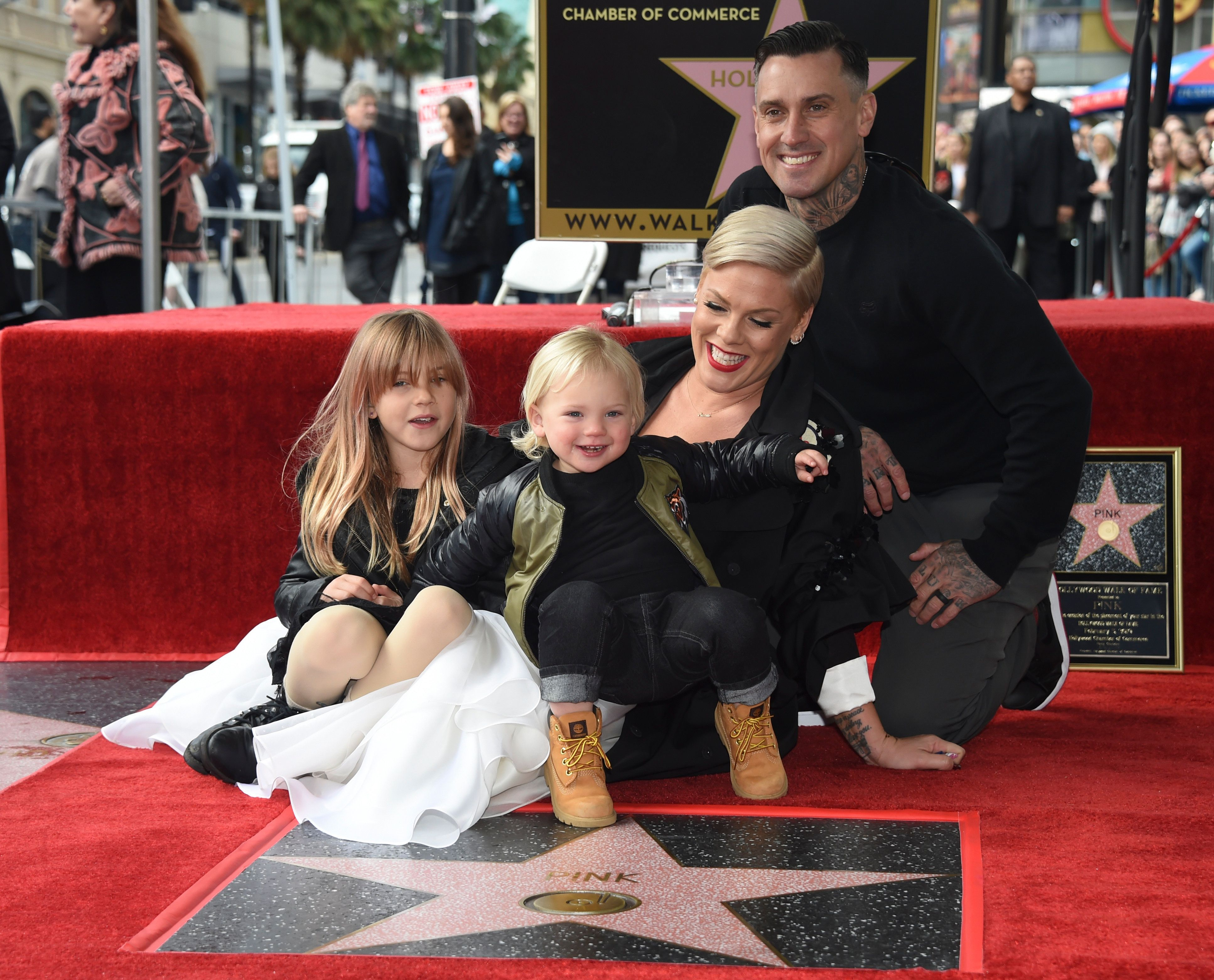 Pink poses with her husband Carey Hart, and children Willow Sage, left, and Jameson at a ceremony honoring Pink with a star on the Hollywood Walk of Fame on Tuesday, Feb. 5, 2019, in Los Angeles. (Photo by Phil McCarten/Invision/AP)