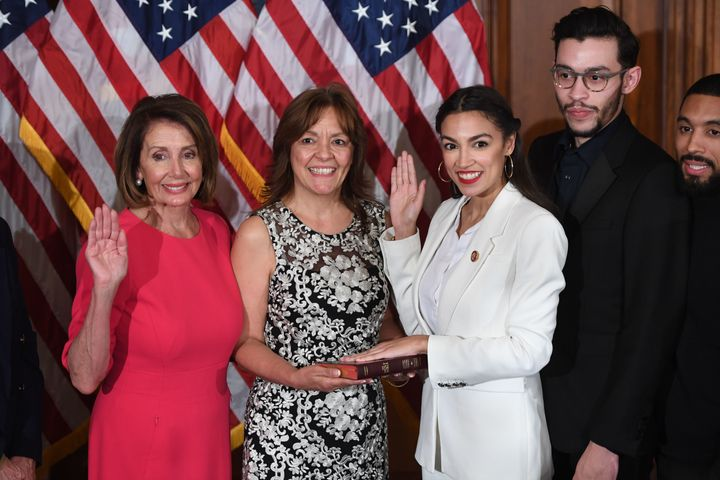 Speaker of the House Nancy Pelosi performs a ceremonial swearing-in for Rep. Alexandria Ocasio-Cortez (D-N.Y.), and her family at the start of the 116th U.S. Congress at the U.S. Capitol in Washington, D.C., Jan. 3, 2019.