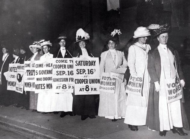 American suffragists with signs in New York.