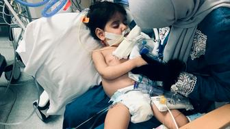 In this December 2018 photo released by the Council on American Islamic Relations, Sacramento Valley, Shaima Swileh, of Yemen, holds her dying 2-year-old son Abdullah Hassan at UCSF Benioff Children's Hospital in Oakland, Calif. The Council on American-Islamic Relations announced Friday, Dec. 28 that Abdullah died at the Oakland hospital, where his father Ali Hassan brought him in the fall to get treatment for a genetic brain disorder. Swileh, who is not an American citizen, sued the Trump administration to let her into the country to be with the ailing boy. (Council on American Islamic Relations, Sacramento Valley via AP)