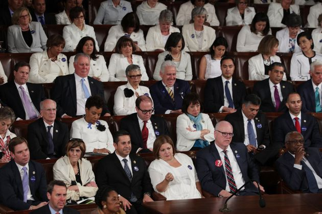 Members of Congress look on as President Trump addresses a joint session of the U.S. Congress on Feb....