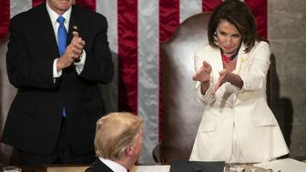 U.S. House Speaker Nancy Pelosi, a Democrat from California, right, and U.S. Vice President Mike Pence, left, applaud U.S. President Donald Trump as he arrives to deliver a State of the Union address to a joint session of Congress at the U.S. Capitol in Washington, D.C., U.S., on Tuesday, Feb. 5, 2019. Trump will speak to a House chamber full of Democrats jostling to challenge his re-election, with many female lawmakers planning to dress in suffragette white and his chief antagonist Nancy Pelosi seated at the dais behind him. Photographer: Al Drago/Bloomberg via Getty Images