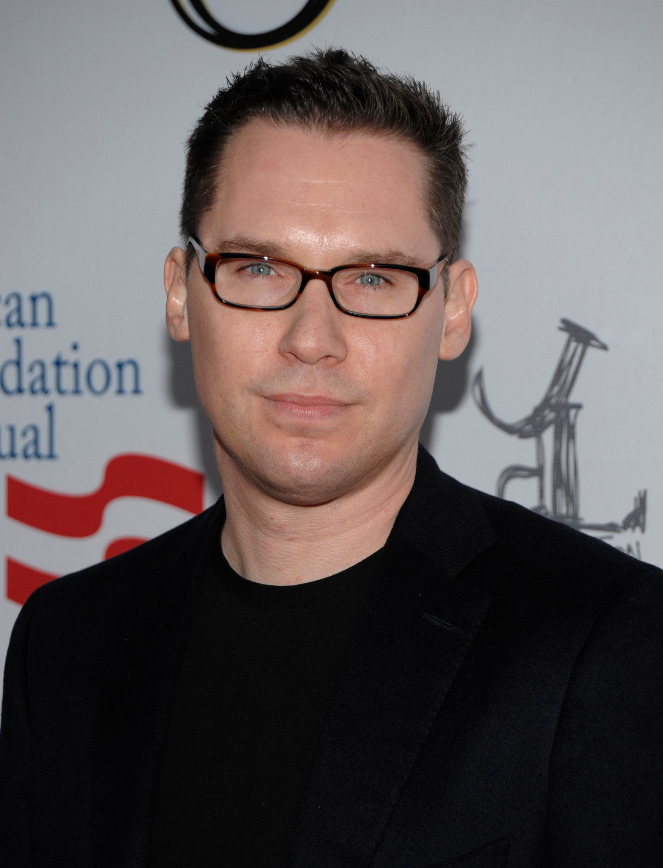 """FILE - In this March 3, 2012 file photo, director Bryan Singer arrives at the Los Angeles premiere of the play """"8"""" in Los Angeles.  Singer released a statement on Thursday, April 24, 2014, denying allegations by Michael Egan III that the director sexually assaulted him when he was underage in 1999 and called them """"outrageous, vicious and completely false."""" The director of the upcoming film """"X-Men: Days of Future Past"""" also said he is avoiding media promotions of the film to avoid creating a distraction. (AP Photo/Dan Steinberg, file)"""