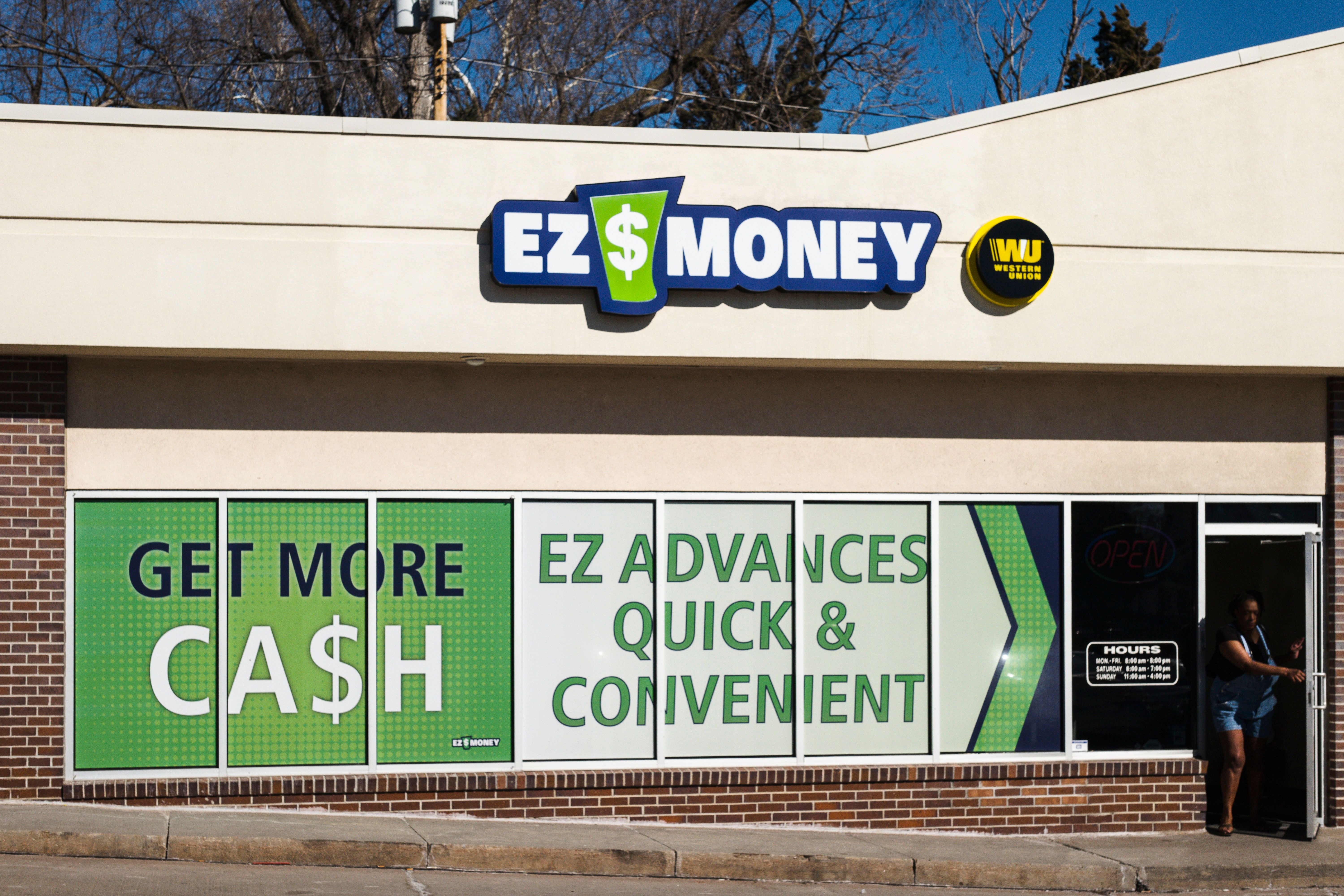 FILE - This Feb. 17, 2017 file photo shows an EZ Money Check Cashing store in Omaha, Neb. About 80 Nebraska businesses offer payday loans, according to the state Department of Banking and Finance, and several of these businesses, including EZ Money, have multiple storefronts. (AP Photo/Nati Harnik, File)