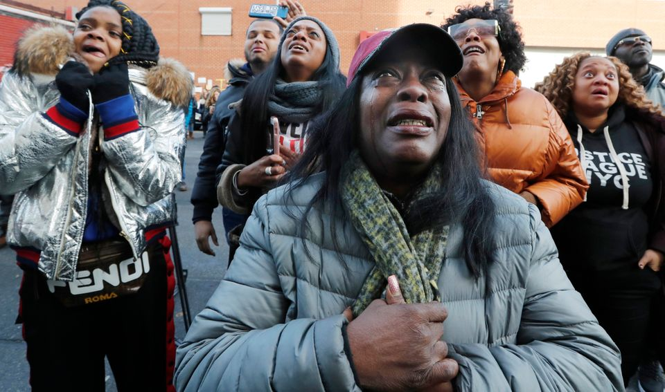 Catana Yehudah, foreground, of the Bronx, cries as she hears the response of prisoners held inside the...