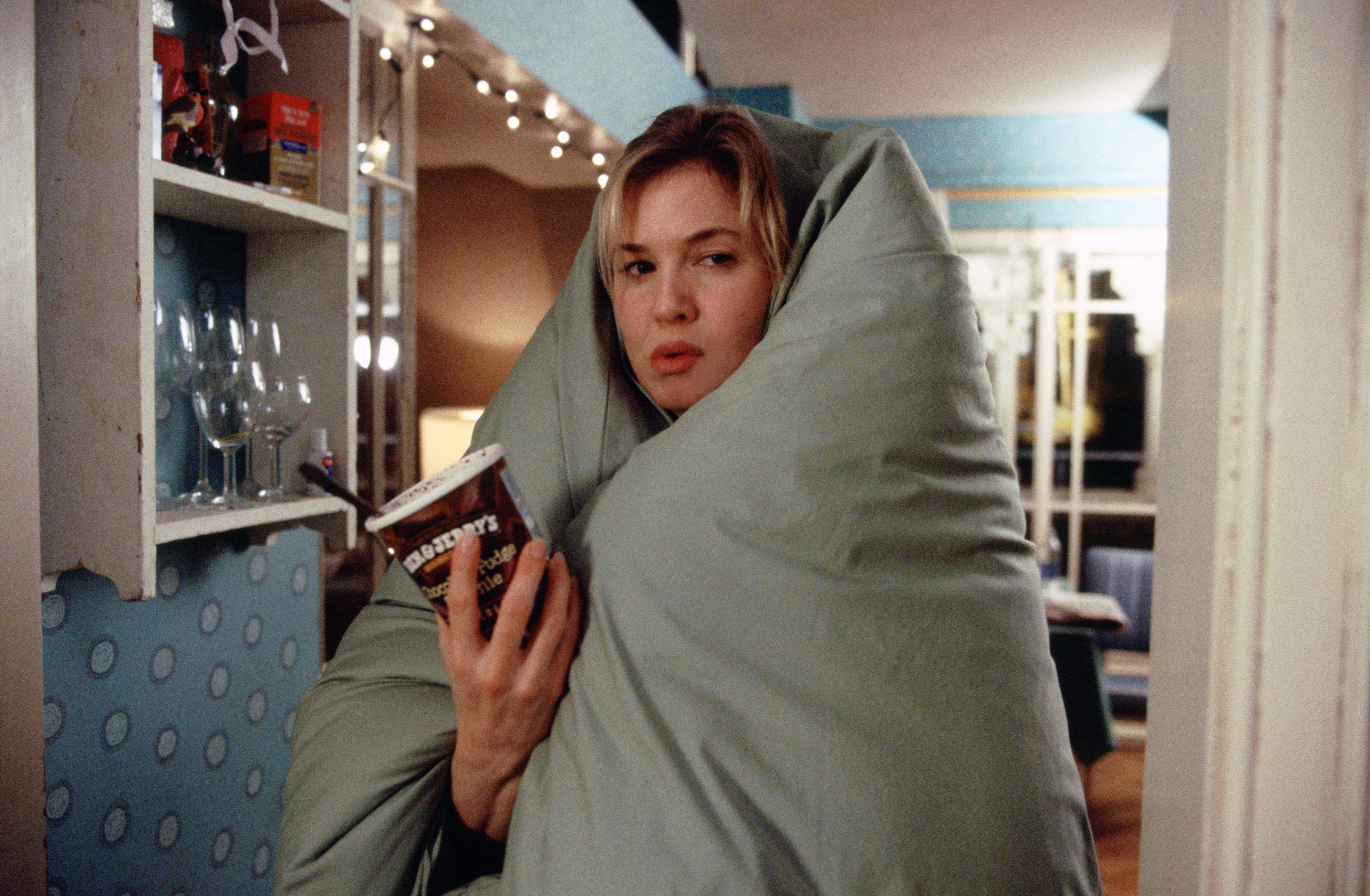 "Bridget Jones cozies up to a pint of Ben & Jerry's in an iconic scene from ""Edge Of Reason."""
