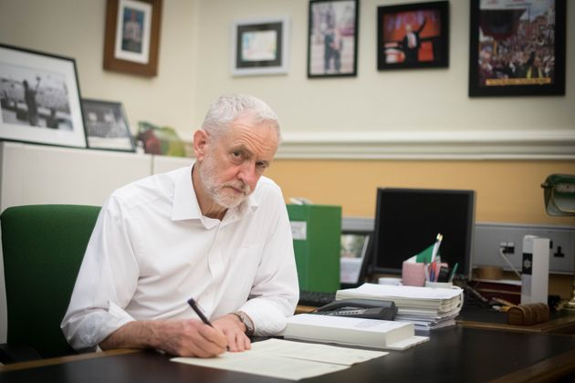 Labour leader Jeremy Corbyn signs a letter he has written to Prime Minister Theresa May laying out Labour's five Brexit demands before she goes to Brussels tomorrow