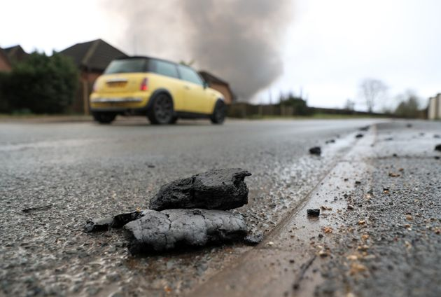 Debris from the Ocado robotic warehouse fire in Andover, litter the road and footpaths of Picket Piece...