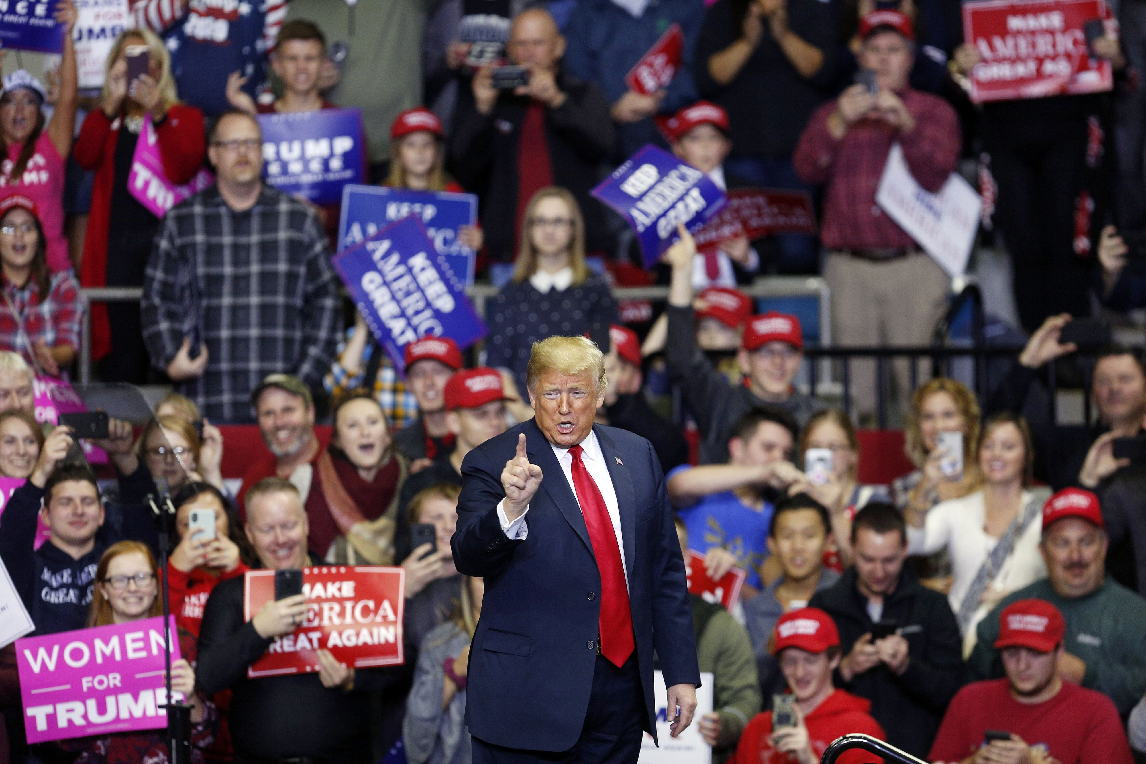 U.S. President Donald Trump gestures during a rally in Fort Wayne, Indiana, U.S., on Monday, Nov. 5, 2018. Trump kicked off his last day of campaigning ahead of elections that will determine control of Congress, as he tweeted support for Republican candidates and condemned their Democratic opponents. Photographer: Luke Sharrett/Bloomberg via Getty Images