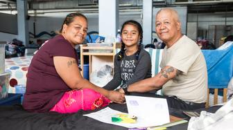 (From left to right) Ketnina Smith, Jennifer Biluk, and Jesse Biluk pose for a portrait at the Kaʻaʻahi Homeless Shelter for Women and Families in Honolulu, HI on Dec. 28, 2018.