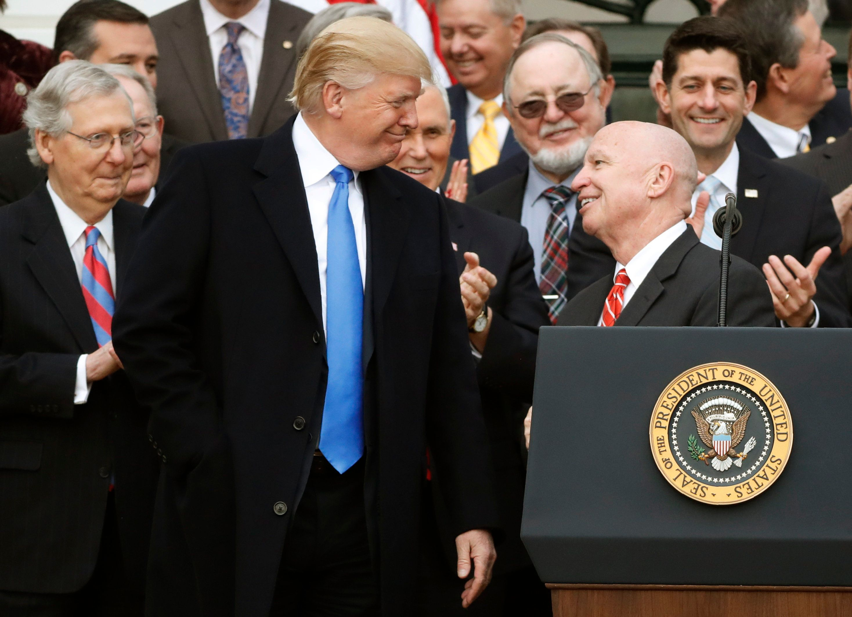 <p>President Donald Trump and House Ways and Means Committee Chairman Kevin Brady smile at each other as Senate Majority Leader Mitch McConnell (L), Vice President Mike Pence, U.S. Rep Don Young and Speaker of the House Paul Ryan look with other Congressional Republicans after the U.S. Congress passed sweeping tax overhaul legislation, on the South Lawn of the White House in Washington, U.S., December 20, 2017. REUTERS/Jonathan Ernst</p>