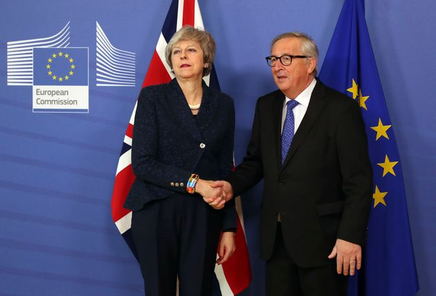 Theresa May in a frosty photo call with Jean-Claude