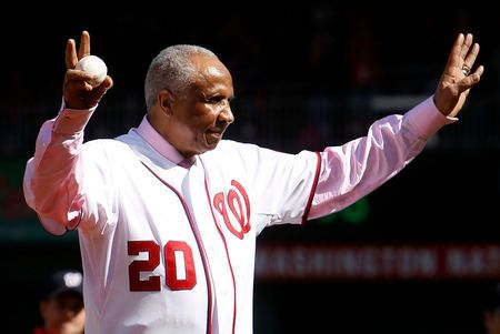 Former Washington Nationals manager Frank Robinson throws out the ceremonial first pitch before Game 3 of the MLB NLDS baseball series between the Washington Nationals and the St. Louis Cardinals in Washington October 10, 2012. REUTERS/Gary Cameron