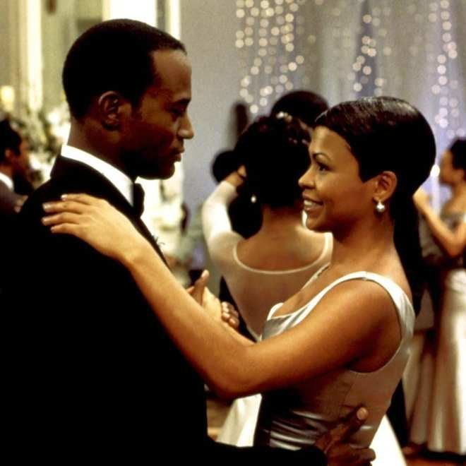 "Taye Diggs and Nia Long share a dance in ""The Best Man."""
