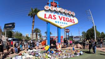 Photo by: gotpap/STAR MAX/IPx 2017 10/6/17 Memorials and tributes in the aftermath of the mass shooting on the Las Vegas Strip (Las Vegas Boulevard) in Las Vegas, Nevada on Sunday, October 1st, 2017. In the attack that was carried out by lone gunman, Stephen Craig Paddock, 64, of Mesquite, Nevada, at least 58 people were killed and more than 500 people were injured in what is now the single largest mass shooting in United States History. From the 32nd floor of The Mandalay Bay Hotel and Casino, Stephen Craig Paddock fired long range automatic weapons at the 23,000 concert-goers below as they attended the Route 91 Harvest Country Music Festival. After the rampage - that lasted approximately 15 minutes by most accounts - Paddock apparently took his own life via a self-inflicted gunshot as police swarmed his hotel room. (Las Vegas, Nevada, USA)