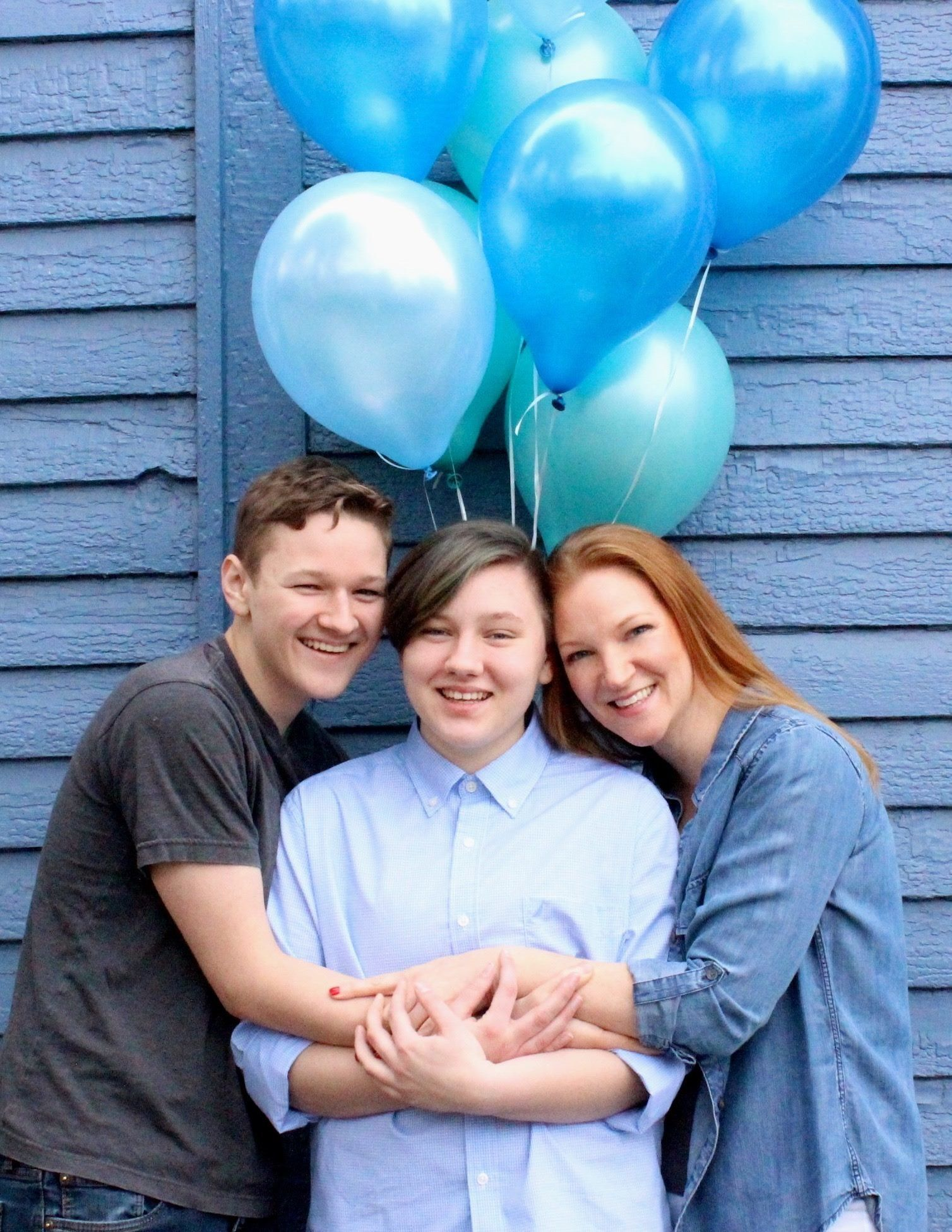 Heather Lundberg Green celebrated her 20-year-old trans son, Adrian (center), with a stunning photo shoot.