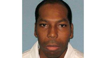 FILE - This undated file photo from the Alabama Department of Corrections shows inmate Dominique Ray.  A federal appeals court has stayed the execution of Ray, a Muslim inmate in Alabama who says the state is violating his religious rights by not allowing an imam at his lethal injection. The 11th U.S Circuit Court of Appeals granted the stay Wednesday, Feb. 6, 2019,  a day before the scheduled lethal injection of Ray.(Alabama Department of Corrections via AP, File)