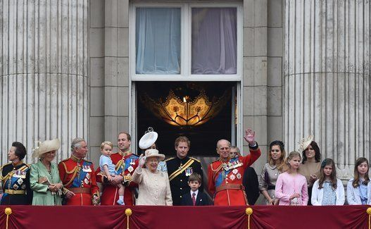 Britain\'s Queen Elizabeth II (front CL) and her husband Prince Philip, Duke of Edinburgh (front CR) wave as they stand on the balcony of Buckingham Palace with (L-R) Britain\'s Princess Anne, Princess Royal, Camilla, Duchess of Cornwall, Prince Charles, Prince of Wales, Prince William, Duke of Cambridge holding his son Prince George of Cambridge, Catherine, Duchess of Cambridge (back), Prince Harry, James, Viscount Severn, Prince Andrew, Duke of York (back), Princess Beatrice of York, Lady Louise Windsor, Princess Eugenie of York at the end of the Queen\'s Birthday Parade, \'Trooping the Colour,\' in London on June 13, 2015. The ceremony of Trooping the Colour is believed to have first been performed during the reign of King Charles II. In 1748, it was decided that the parade would be used to mark the official birthday of the Sovereign. More than 600 guardsmen and cavalry make up the parade, a celebration of the Sovereign\'s official birthday, although the Queen\'s actual birthday is on 21 April.  AFP PHOTO / BEN STANSALL        (Photo credit should read BEN STANSALL/AFP/Getty Images)