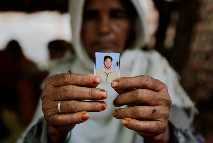 In this file photo, Kareeman Bano holds a photograph of her son-in-law Rakbar Khan who died after being thrashed by a mob in June 2018 on suspicion of cattle smuggling in Alwar, Rajasthan.
