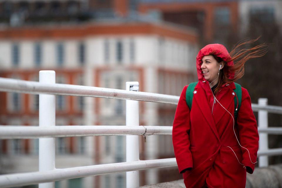 A woman battles strong winds on London's Waterloo bridge on