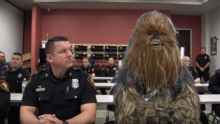 Fort Worth Police Officer Jimmy Pollozani gets ready to make the rounds with his rookie — make that Wookiee — partner of the