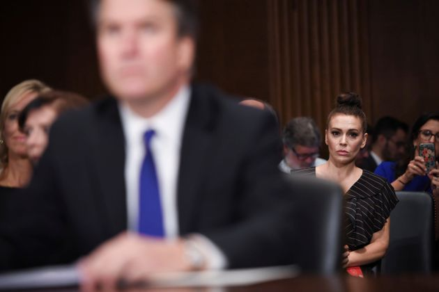Actress Alyssa Milano listens as Supreme Court nominee Brett Kavanaugh testifies before the Senate Judiciary Committee on Sept. 27, 2018.