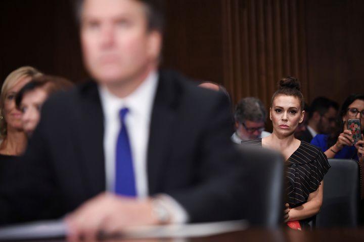 Actress Alyssa Milano listens as Supreme Court nominee Brett Kavanaugh testifies before the Senate Judiciary Committee on Sept. 27, 2018.