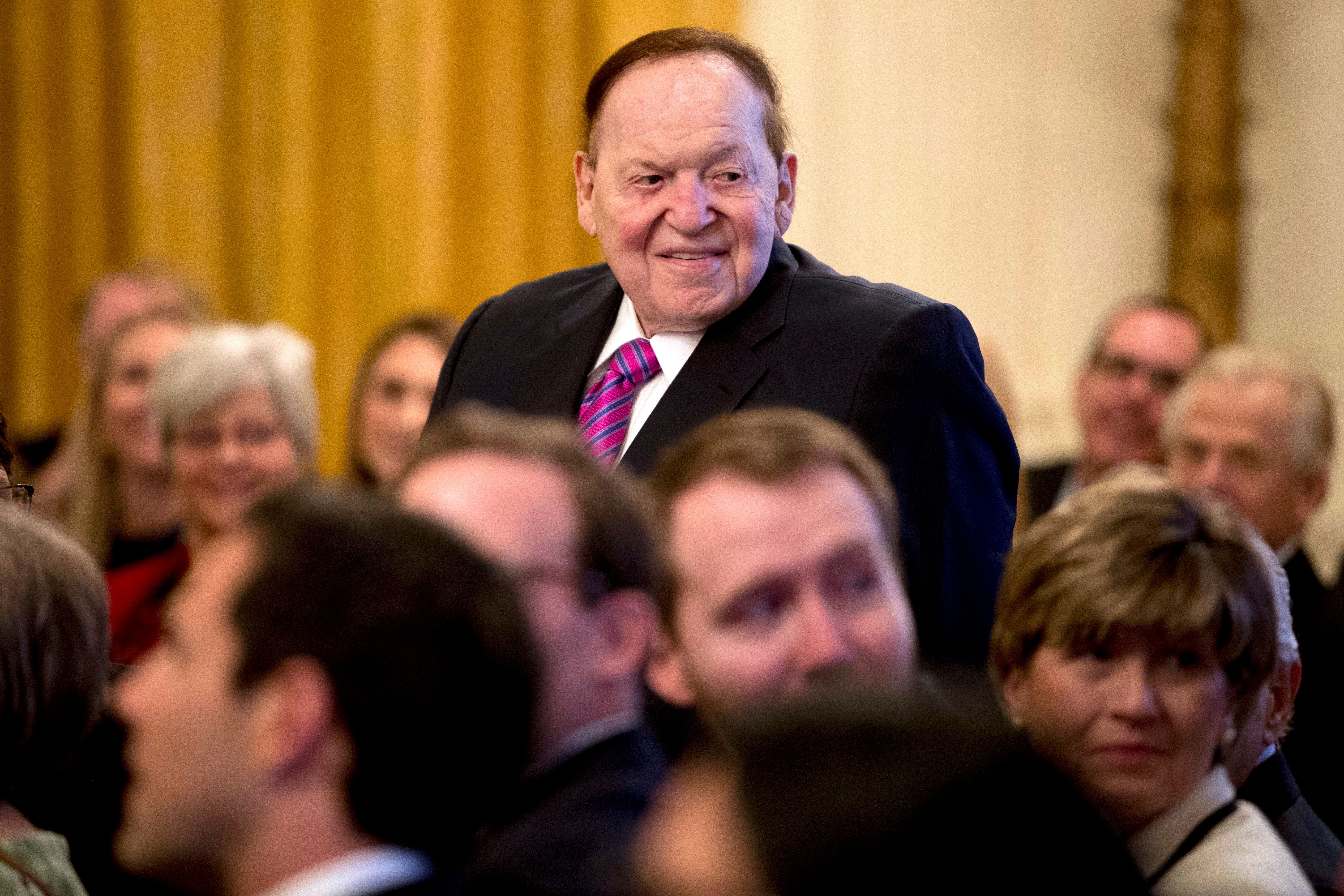 Sheldon Adelson attends a White House ceremony to see his wife, Miriam, receive the Medal of Freedom from President Donald Trump in November 2018.