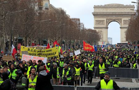 Protesters wearing yellow vests take part in a demonstration.
