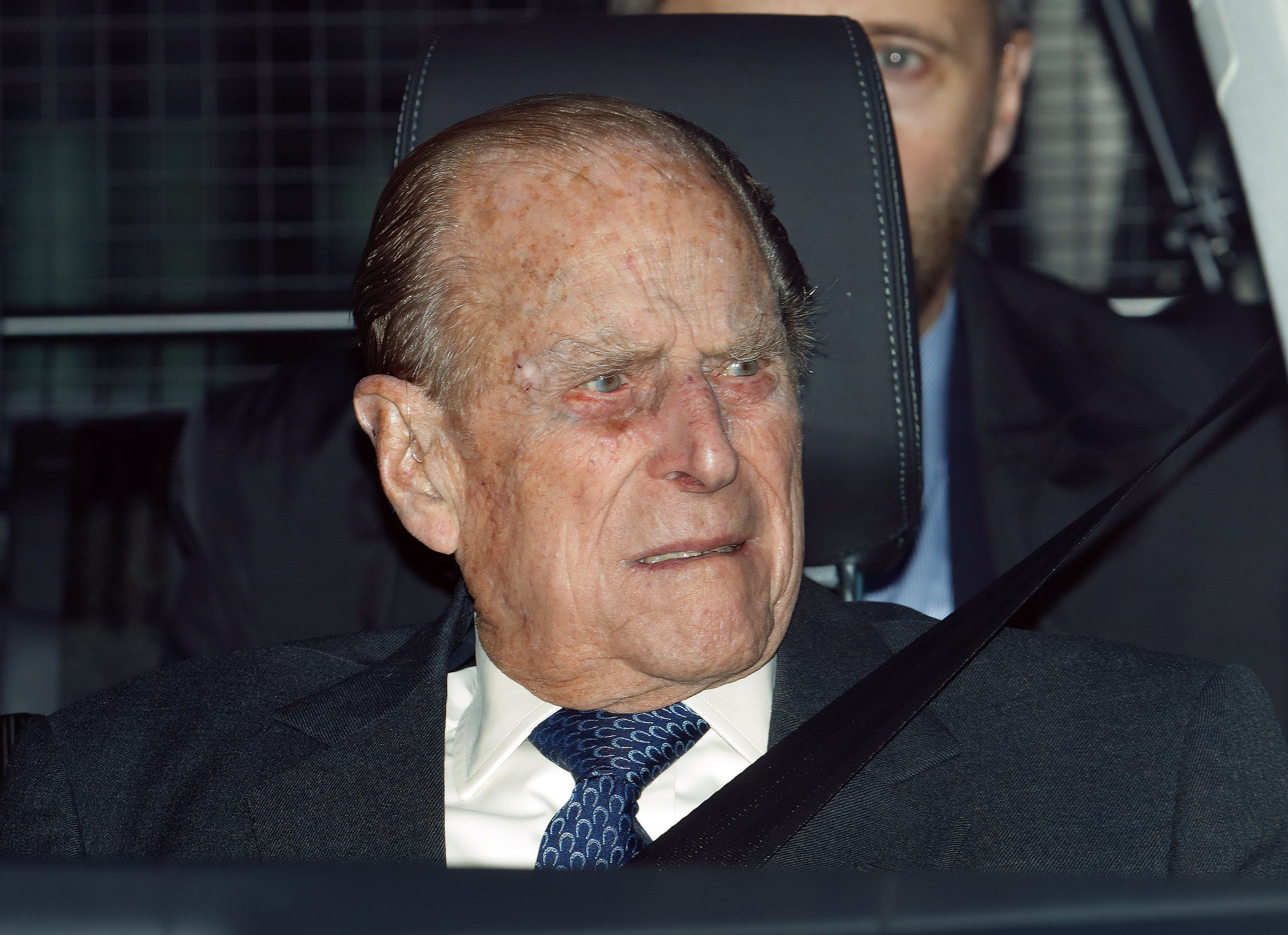 Prince Philip, 97, gives up licence after furore over car crash