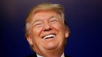 U.S. President Donald Trump laughs while hosting a CEO town hall on the American business climate at the Eisenhower Executive Office Building in Washington, U.S., April 4, 2017. REUTERS/Kevin Lamarque