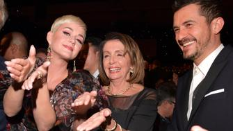 LOS ANGELES, CA - FEBRUARY 08:  (L-R) Katy Perry, Nancy Pelosi and Orlando Bloom attend MusiCares Person of the Year honoring Dolly Parton at Los Angeles Convention Center on February 8, 2019 in Los Angeles, California.  (Photo by Lester Cohen/Getty Images for The Recording Academy)