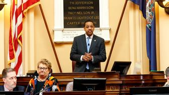Virginia Lt. Gov. Justin Fairfax presides over the Senate at the Capitol in Richmond, Va., Monday, Feb. 4, 2019. Virginians are now taking a closer look at Fairfax as he suddenly looms as the successor to Gov. Ralph Northam, whose political future is in jeopardy after a blackface photo was discovered on Northam's personal page in his medical school yearbook. (AP Photo/Steve Helber)