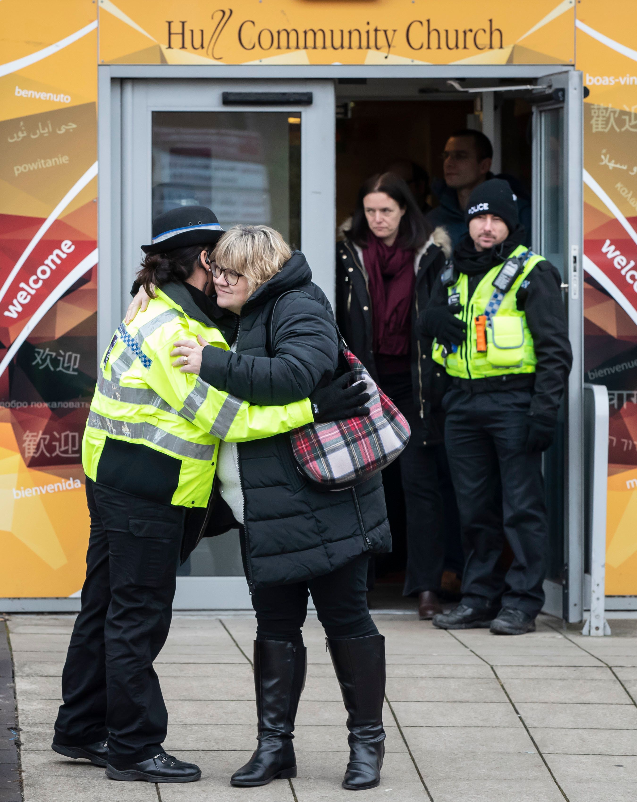Lisa Squire, the mother of missing student Libby Squire, hugs a police officer on leaving a service at...