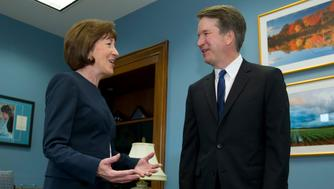 FILE- In this Tuesday, Aug. 21, 2018, file photo, Sen. Susan Collins, R-Maine, speaks with Supreme Court nominee Judge Brett Kavanaugh at her office, before a private meeting on Capitol Hill in Washington. The end of contentious confirmation hearings for U.S. Supreme Court nominee Kavanaugh is shifting the focus to potential swing votes like Republican Sen. Susan Collins of Maine. (AP Photo/Jose Luis Magana, files)