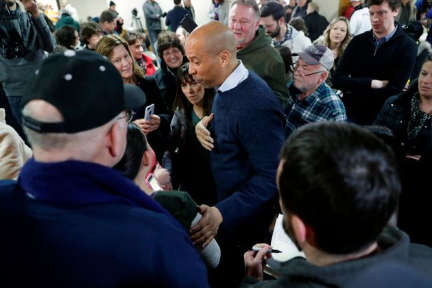 Booker minged with voters at the First Congregational United Church of Christ on Friday in Mason City,