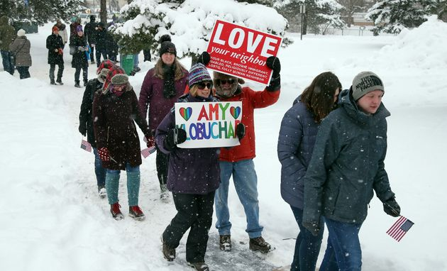 Snow falls Sunday as rallygoers arrive at Boom Island Park in Minneapolis for Democratic Sen. Amy Klobuchar's...