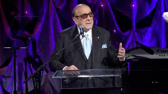 Clive Davis speaks at the Pre-Grammy Gala And Salute To Industry Icons at the Beverly Hilton Hotel on Saturday, Feb. 9, 2019, in Beverly Hills, Calif. (Photo by Chris Pizzello/Invision/AP)