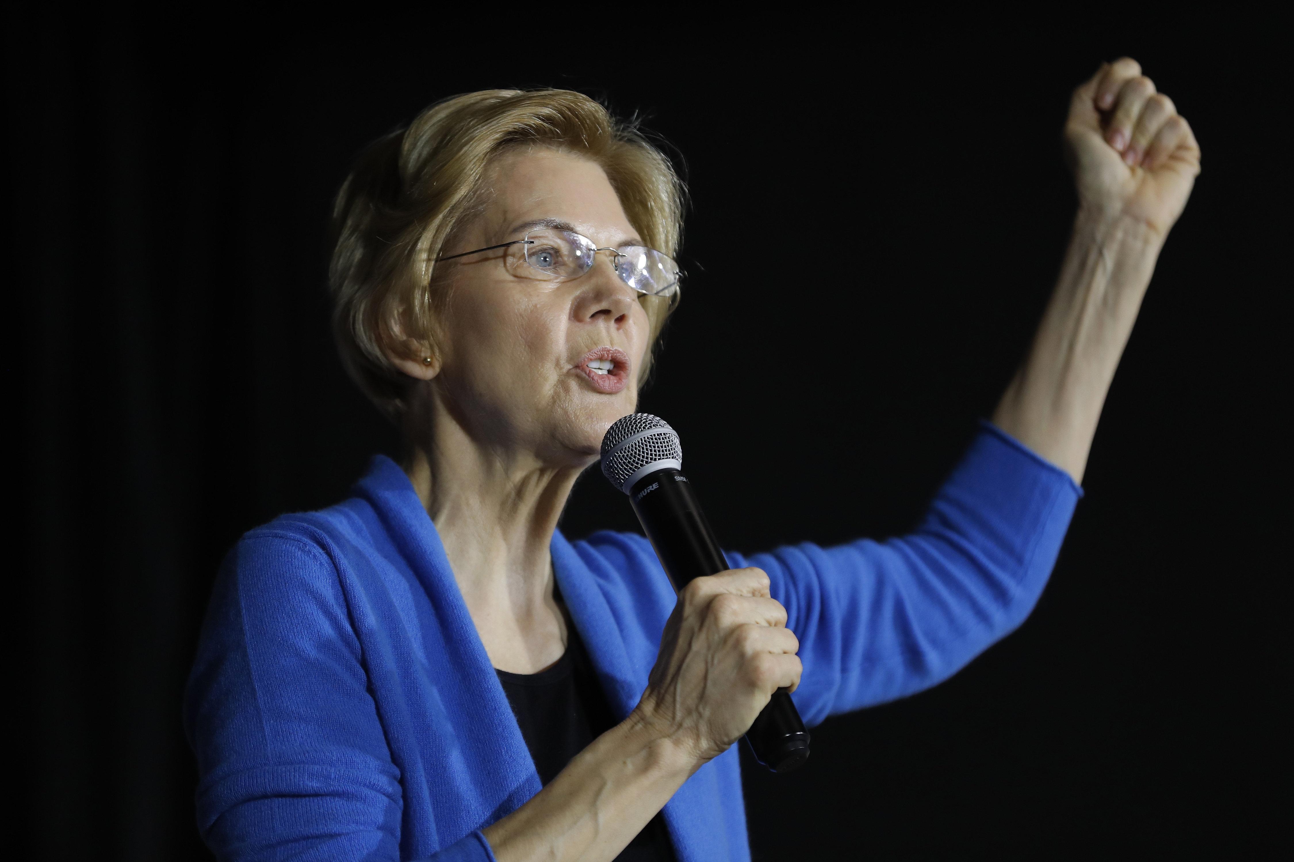 Sen. Elizabeth Warren (D-Mass.) speaks to local residents during a rallyin Cedar Rapids, Iowa, on Sunday.