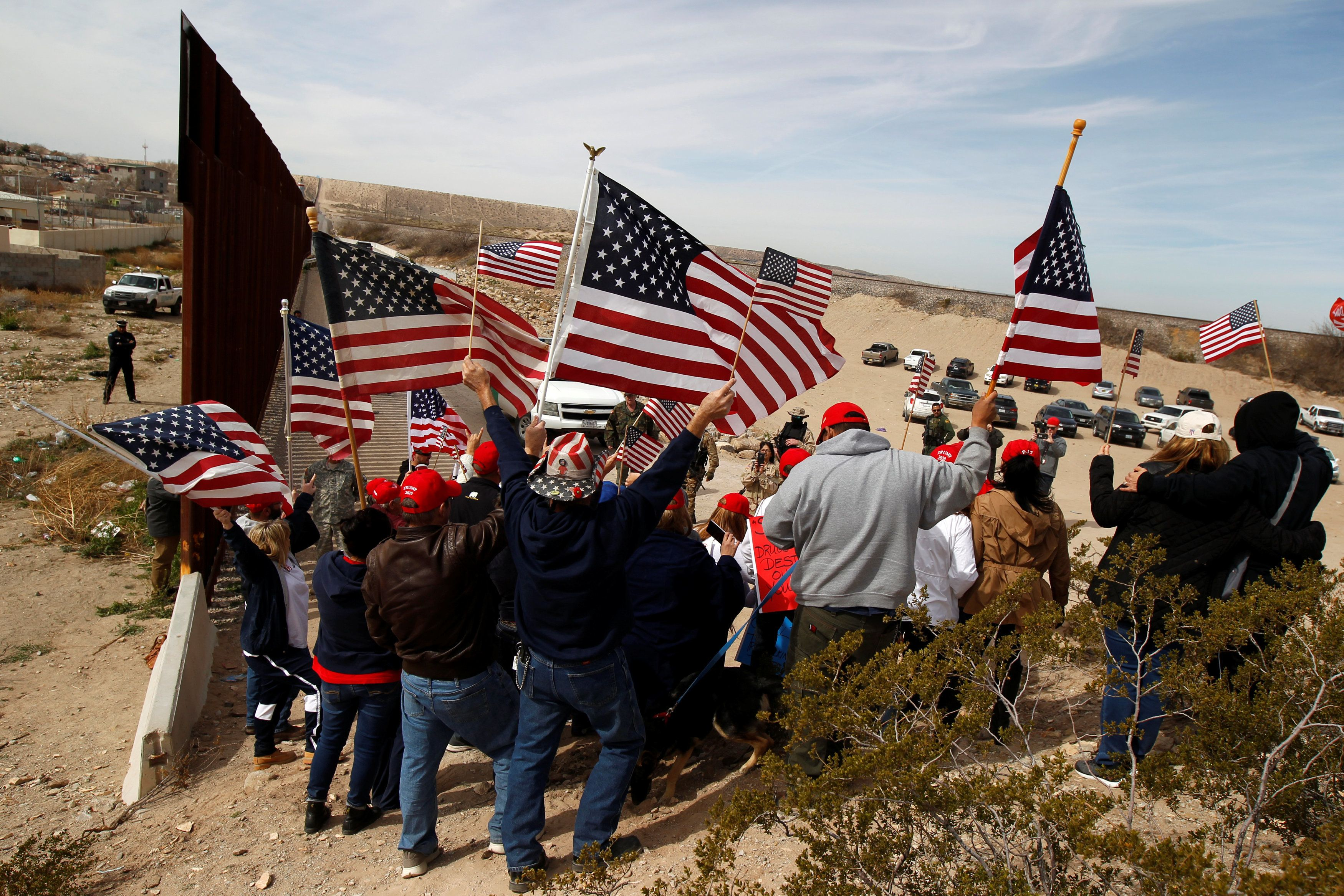 U.S demonstrators hold U.S flags at the open border to make a human wall in support of the construction of the new border wall between U.S and Mexico in Ciudad Juarez, Mexico February 9, 2019. REUTERS/Jose Luis Gonzalez