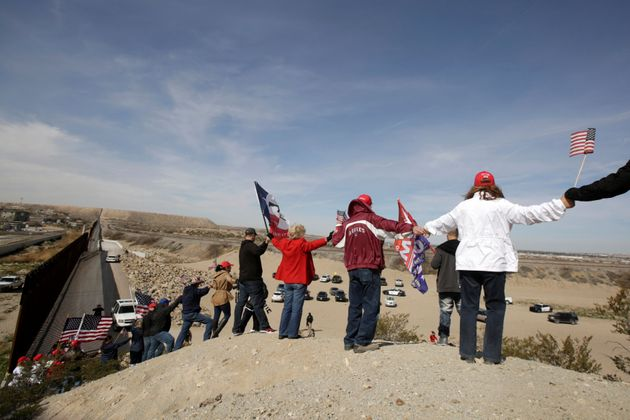 The protesters gathered near an open section of the U.S.-Mexico border in Sunland Park, New