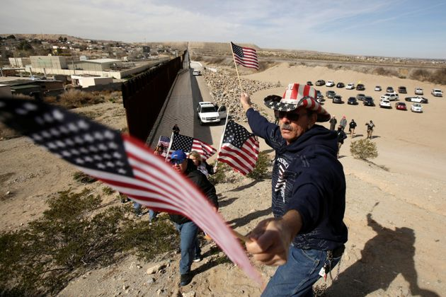 Waving U.S. flags, the protesters chanted,