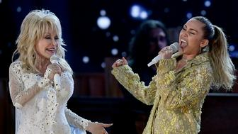 LOS ANGELES, CALIFORNIA - FEBRUARY 10: Dolly Parton (L) and Miley Cyrus perform onstage during the 61st Annual GRAMMY Awards at Staples Center on February 10, 2019 in Los Angeles, California. (Photo by Kevork Djansezian/Getty Images)