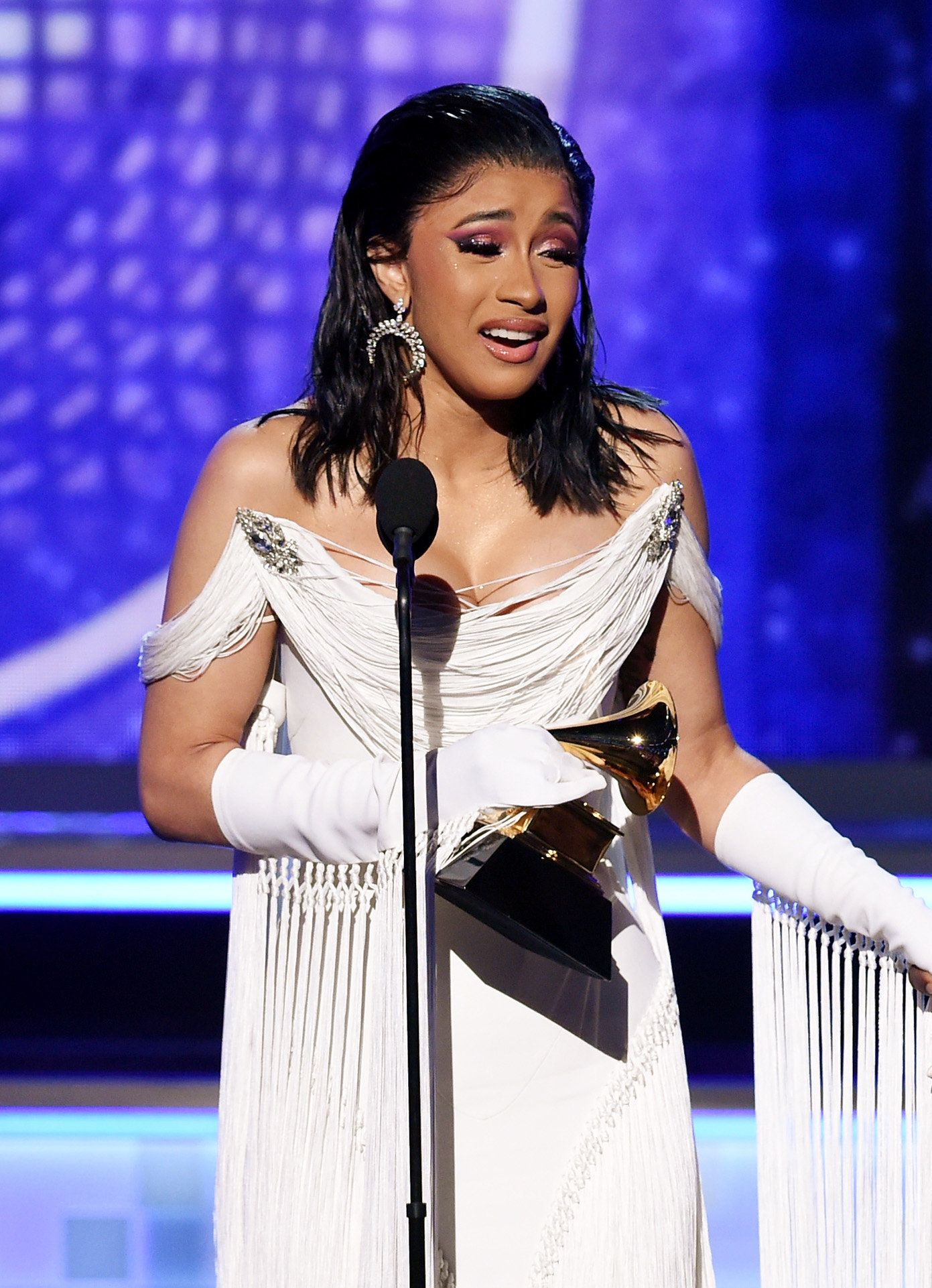 LOS ANGELES, CA - FEBRUARY 10:  Cardi B accepts the Best Rap Album for 'Invasion of Privacy' onstage during the 61st Annual GRAMMY Awards at Staples Center on February 10, 2019 in Los Angeles, California.  (Photo by Kevin Winter/Getty Images for The Recording Academy)